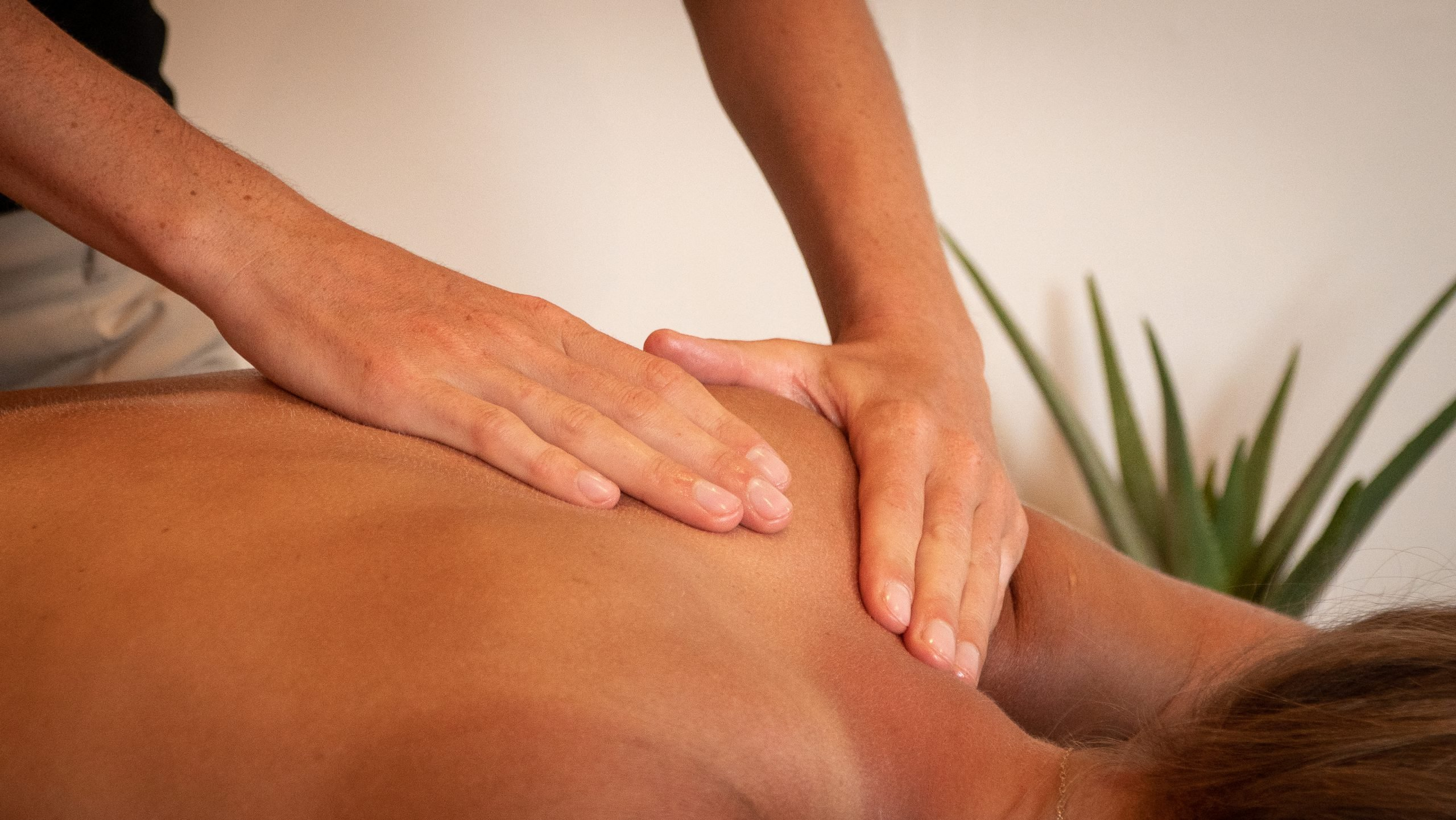 A deep tissue massage style. Back neck and shoulder massage