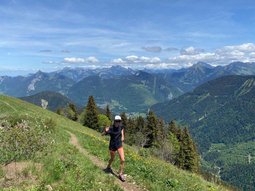 Trail running summer mountains, blue sky.