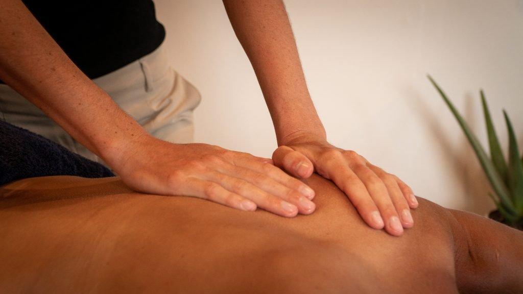 Deep tissue back massage. Hands massaging a persons back