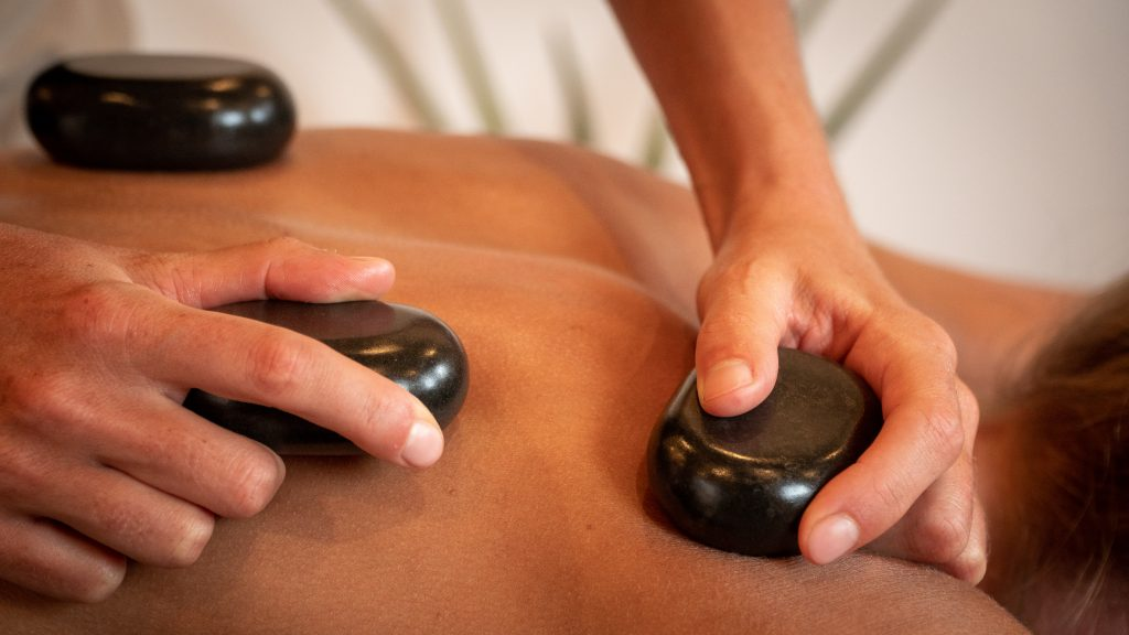 Hot Stone massage on your back and shoulders
