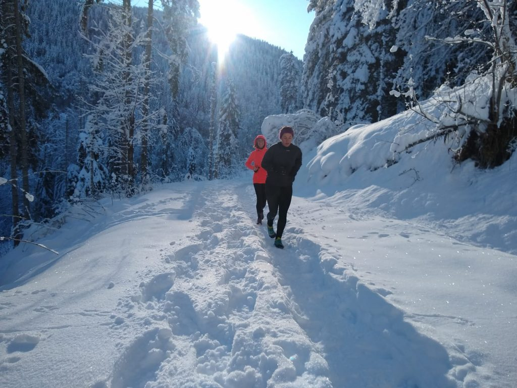 trail running in the snow in morzine